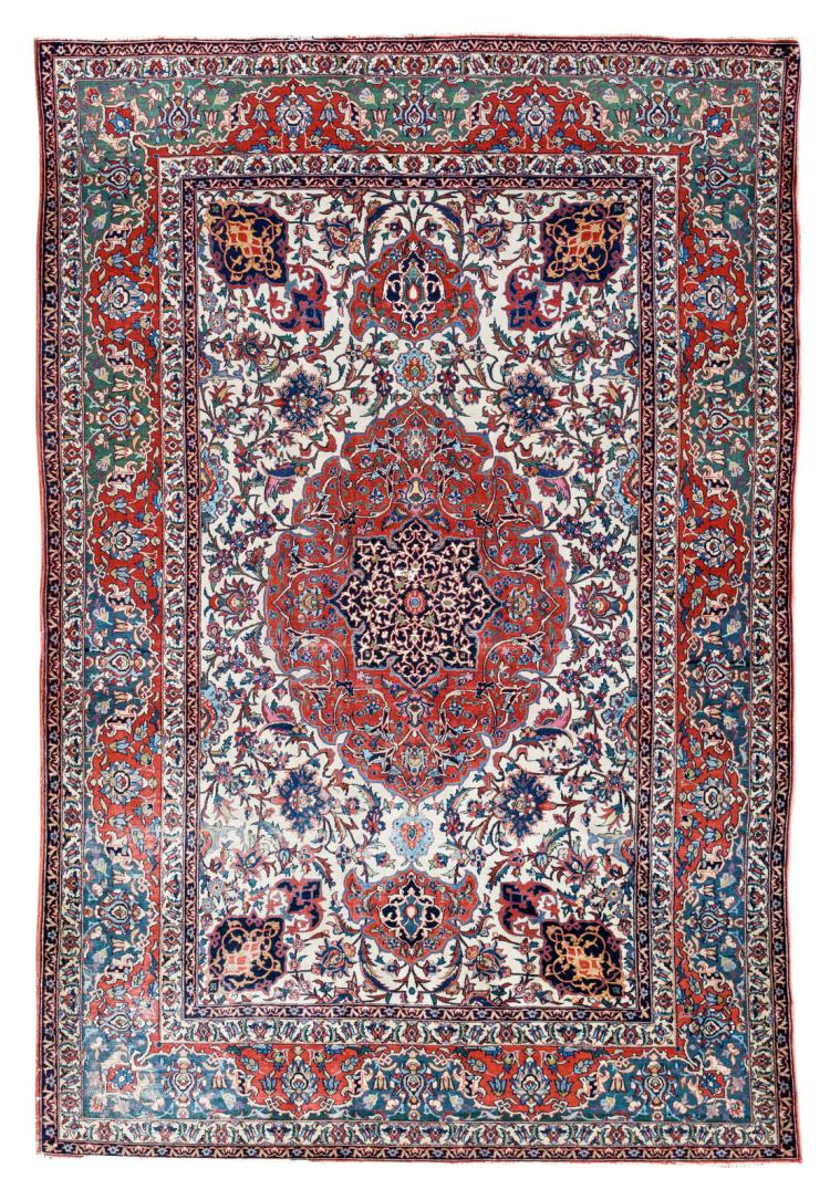 A fine Persian rug, wool and silk on cotton, decorated with floral motifs and a central medallion, 143,5 x 218,5 cm