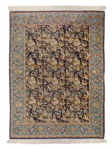 An Oriental rug, wool and silk on cotton, Isfahan, decorated with floral motifs, birds and wolves, 106 x 151 cm