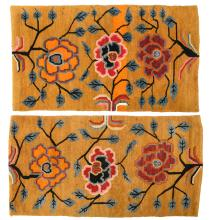 A pair of Sino-Tibetan carpets, wool on cotton, with styled floral motifs, 63 x 85 and 66 x 88 cm