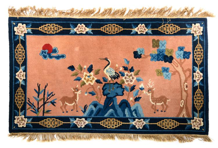 A Chinese carpet decorated with a crane and deer in a landscape, wool on cotton, 80 x 138 cm