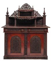 A richly carved exotic hardwood colonial sideboard, H 179 - W 154 - D 71 cm