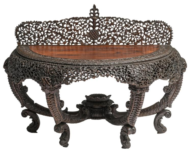 An Oriental open work and richly carved exotic hardwood side table with floral motifs, H 108 - W 146 - D 70 cm