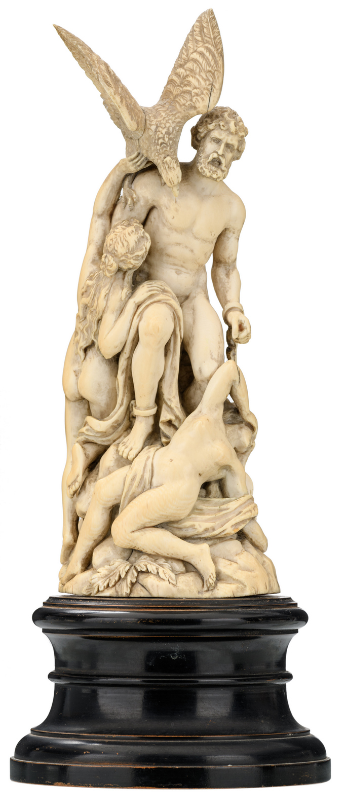 A second half of the 19thC ivory sculpture depicting the punishment of Prometheus, on an ebonized wooden base, probably Paris or Dieppe, H 26,5 (without base) - 34,5 cm (with base)