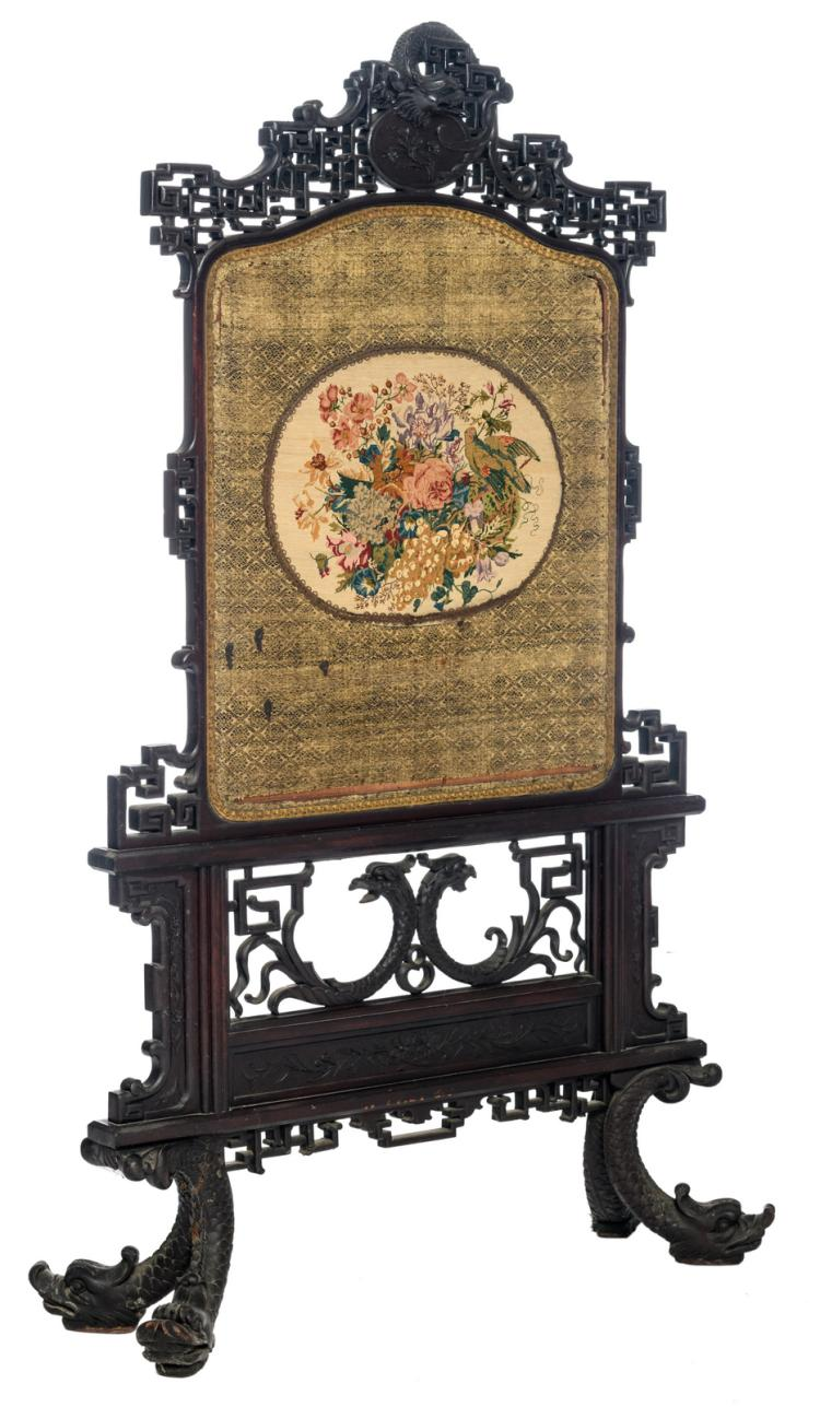 A late 19thC Oriental inspired heatscreen with central embroidery in petit point,H 139 - W 84 - D 28,5 cm