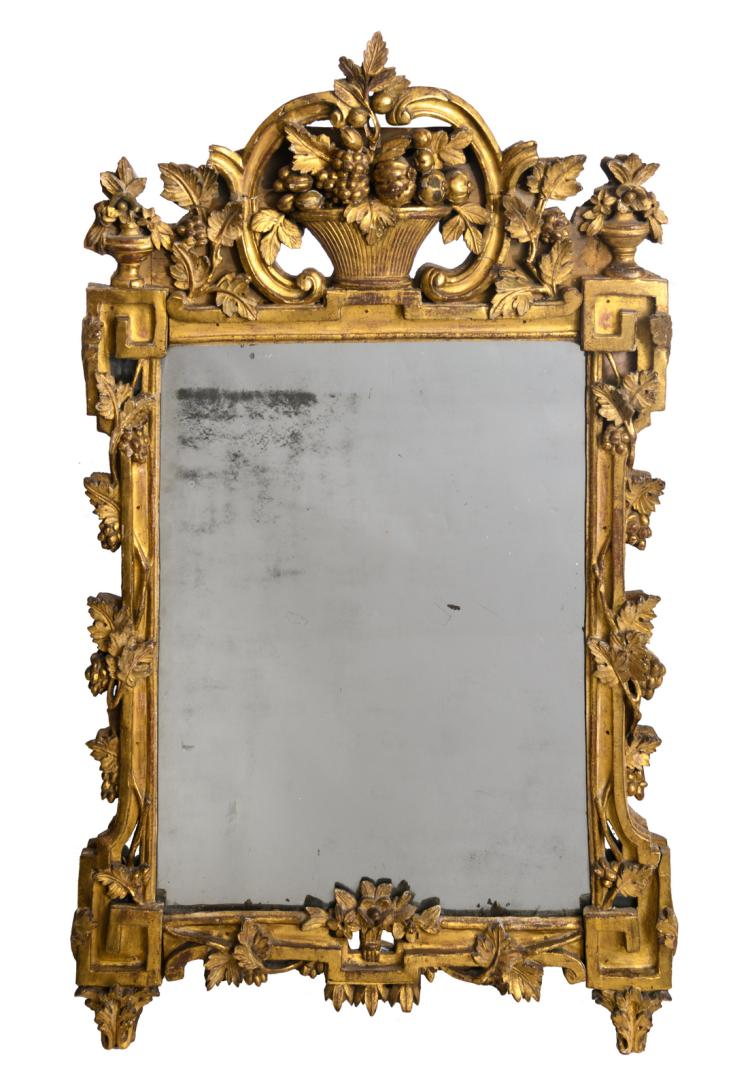A mirror in a carved and gilt wooden Neoclassical 18thC frame, H 120,5 - W 73 cm