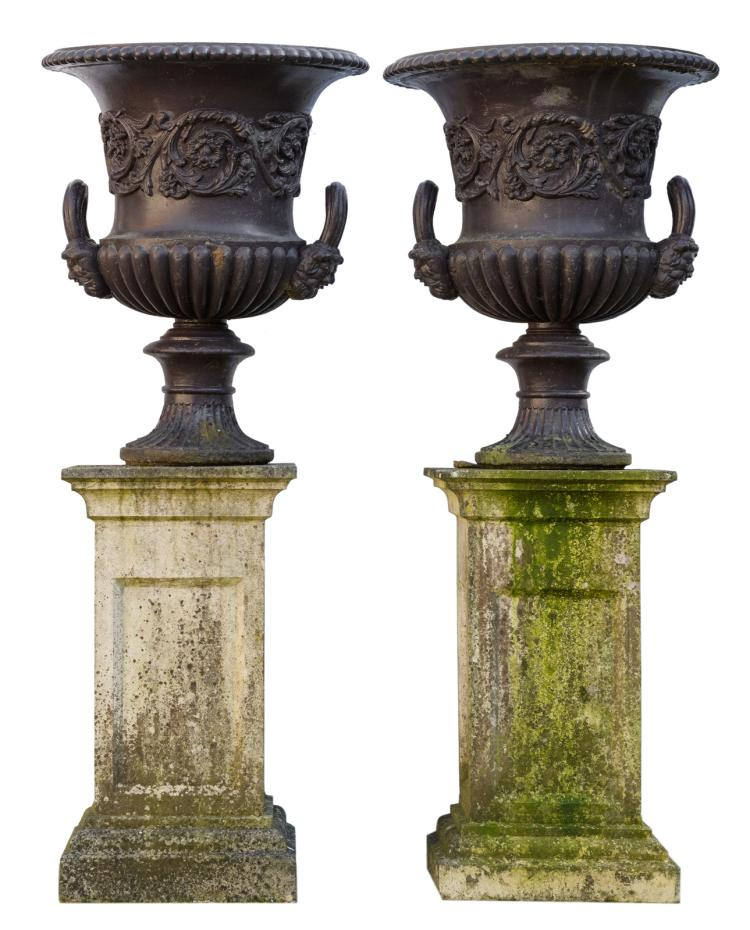 A pair of patinated cast iron Medici garden vases on accompanying reconstituted stone pedestals,H 146,5 - W 58 - D 58 cm