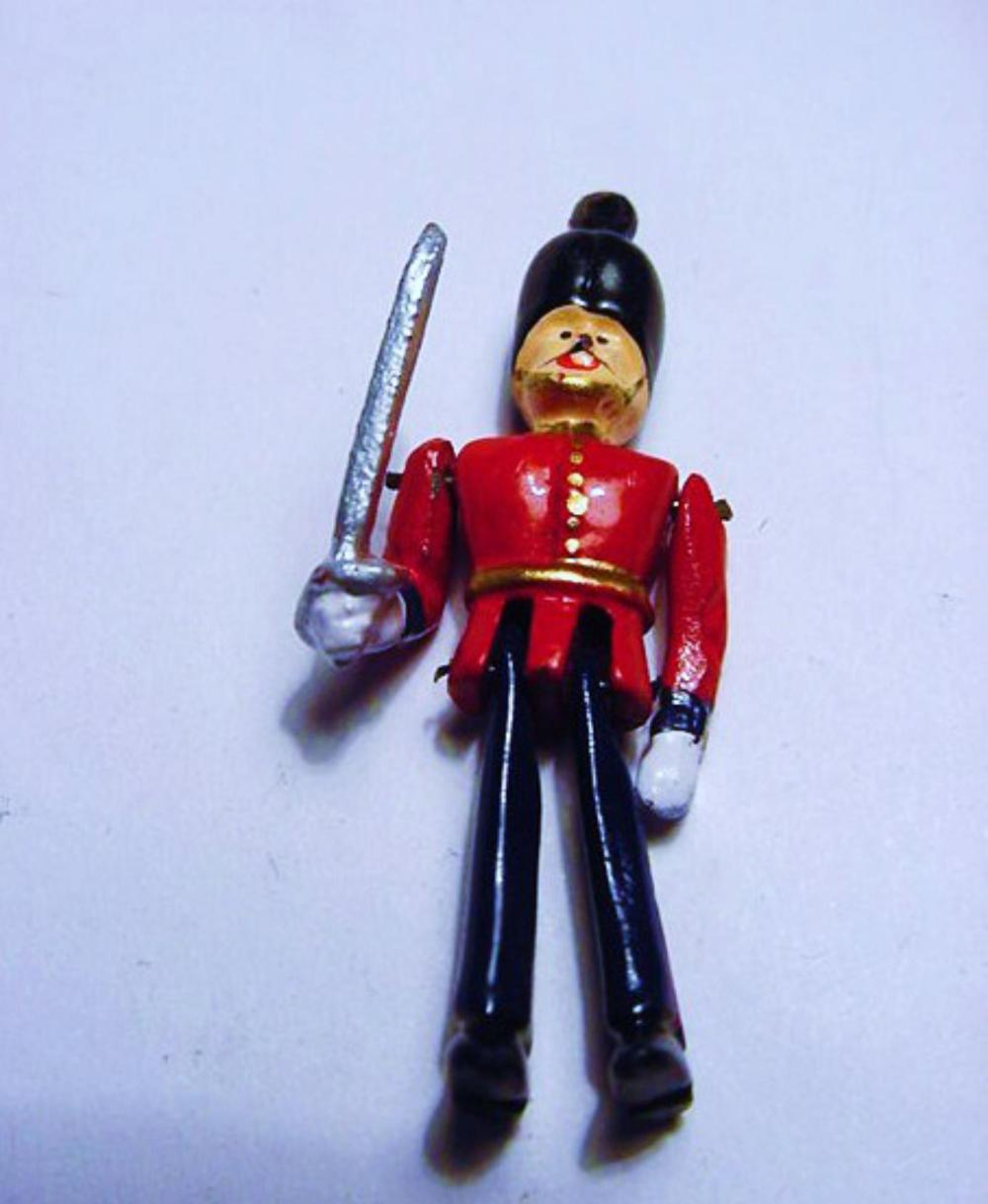 VINTAGE  HAND  PAINTED  METAL MOVEABLE TOY SOLDIER PENDANT