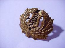 MILITARY MUSICAL CORD HAT BADGE