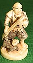 Ivory  Netsuke, Man with Cat, signed