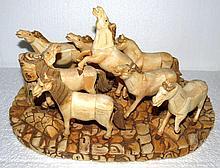 Eight Bone Carvings of Horses on Base