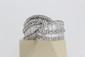 Bague Tresse en or sertie de brillants et de diamant baguettes. POIDS 7,7g