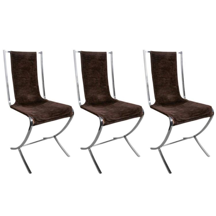 JANSEN - vers 1960 Suite de 11 chaises en cuir tendu et acier profilé