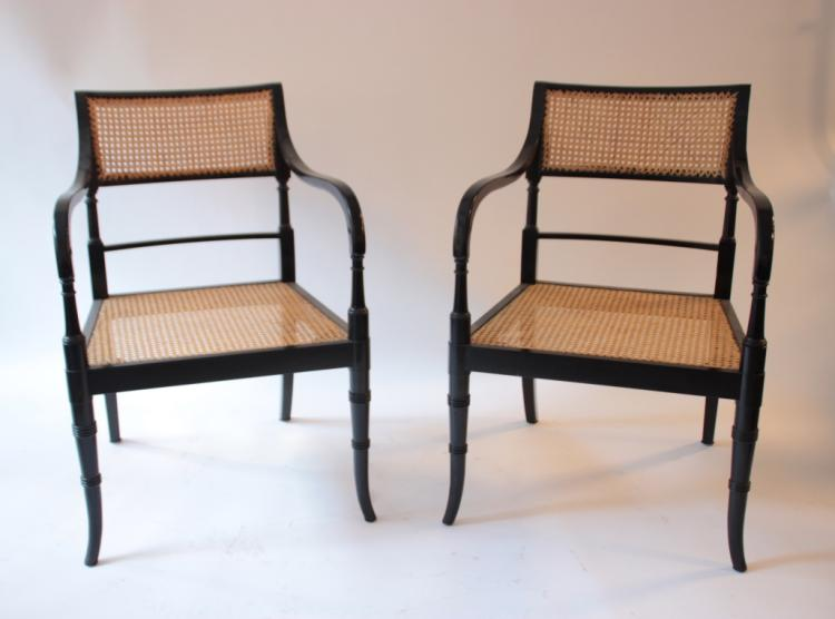 JANSEN Décorateur - Vers 1960  Paire de fauteuils à bâti stylisé avec accoudoirs en bois laqué et cannage reposant sur des pieds à réception pointe