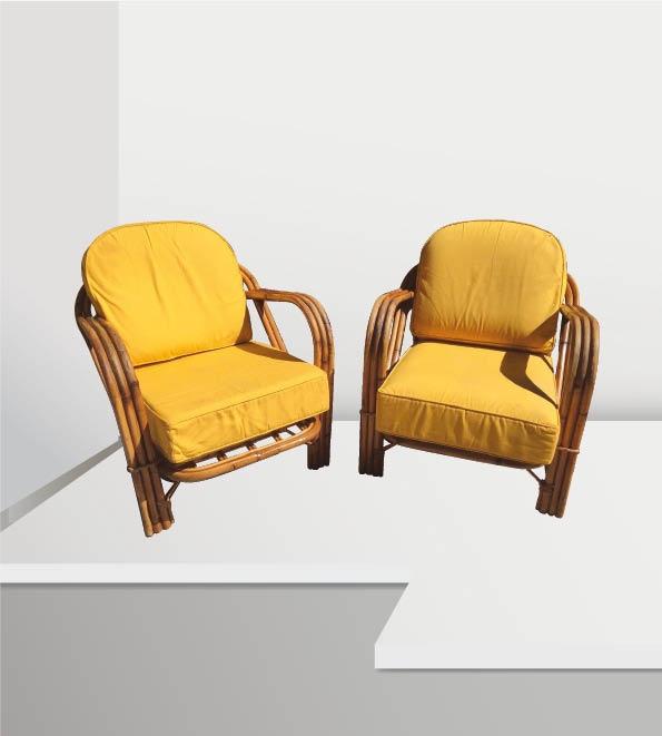 AUDOUX-MINET (XX) Paire de fauteuils en rotin à assise en tissu jaune
