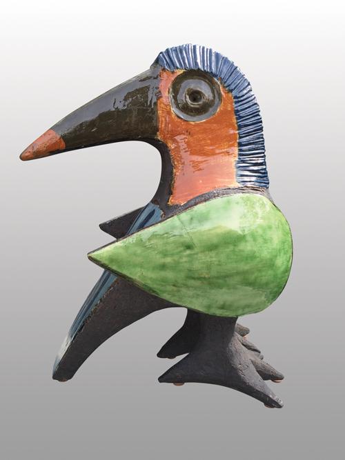 Dominique POUCHAIN (1956)  Oiseau en terre chamottée et vernissée de couleur vert, marron et bleu sur fond noir