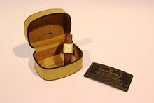 MICHEL HERBELIN  Montre de dame en métal plaqué or , cadran rectangulaire, chiffres romains, bracelet de cuir marron  Année 1987 avec sa carte d'authenticité et son écrin
