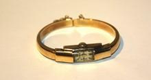 SILVANA  Montre de dame en or (14 carats)jaune à bracelet rigide monté sur ressorts , années 1940 , P: 12 g
