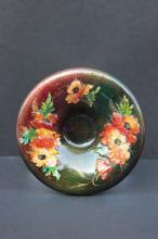 Camille FAURe (1874-1956) - LIMOGES  Petite assiette creuse a decor dâ??emaux translucides sur cuivre a motif floral sur fond vert et orange.