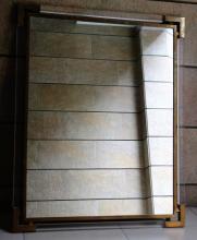 Guy LEFEBVRE - vers 1970.  Important miroir rectangulaire a structure en metal dore et altuglas.