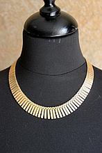 Collier en or jaune style Art déco semi rigide
