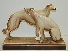 Pair Deco porcelain dogs. H:15