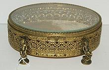 Bronze and crystal covered box raised on figures of