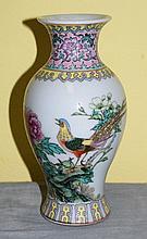 Antique Chinese porcelain vase with mark on bottom.