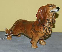 German porcelain figure of a dog. H:6. 5