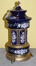 Bronze and porcelain music box lipstick holder. H:13