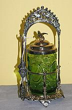 Antique silver plate and glass pickel jar on stand.