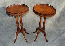 Pair mahogany inlaid side tables raised on four legs.