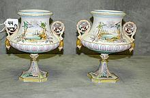 Pair painted bisque urns. H:9