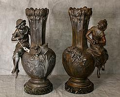 Large pair of bronzed figural vases on marble bases