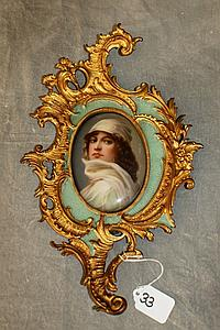 Gilt and painted broze framed porcelain plaque of a