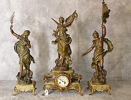 Three piece bronzed figural clock set raised on bronzed