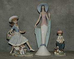 Three lladro figural groups. Largset H:13.5