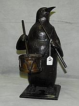 Large antique bronze penguin playing a drum, signed.