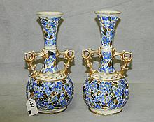 Pair of fischer porcelain vases with holes on bottom.