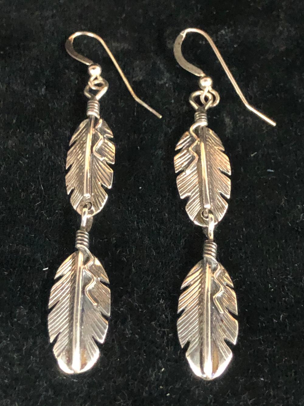 Double feather sterling silver earrings