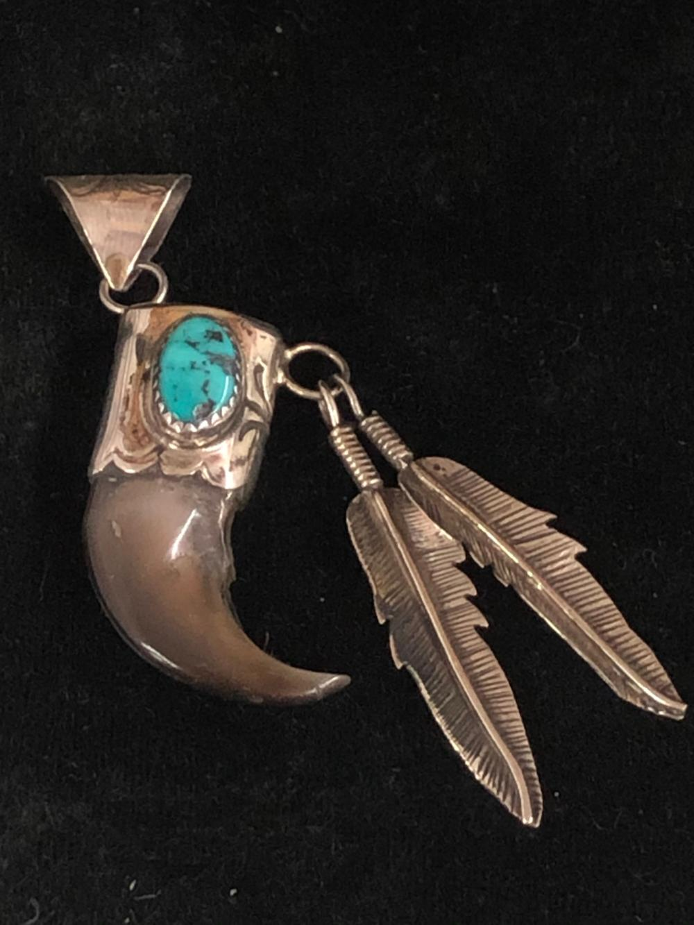 Bear claw sterling silver pendant with two feathers