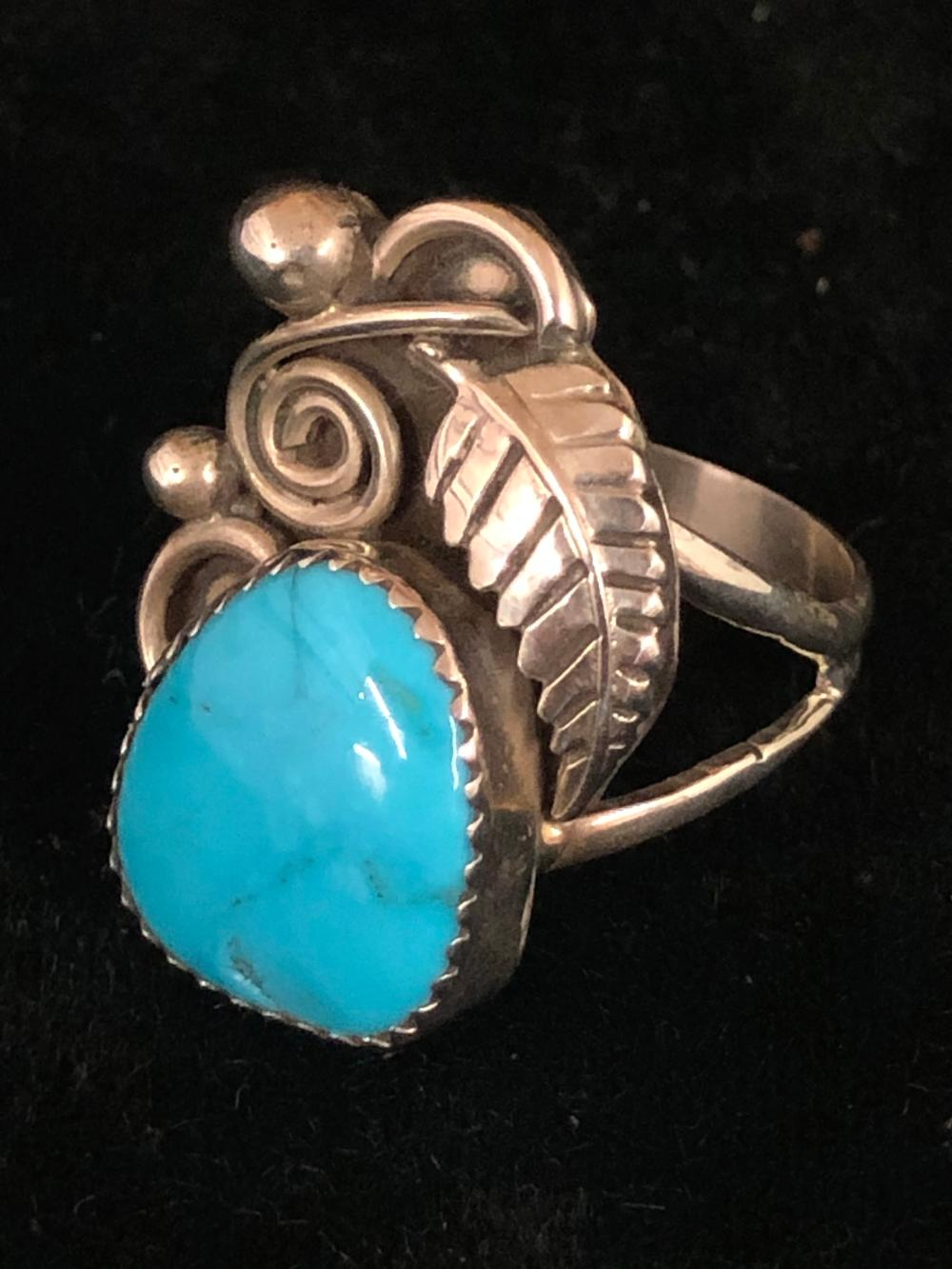 Turquoise with feather design sterling silver ring
