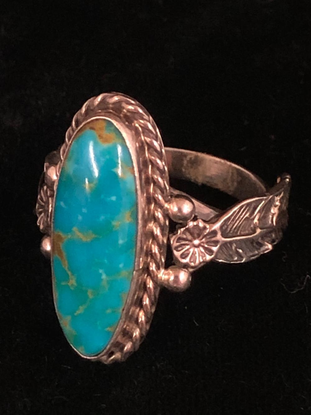Oval turquoise stone sterling silver ring with feather design