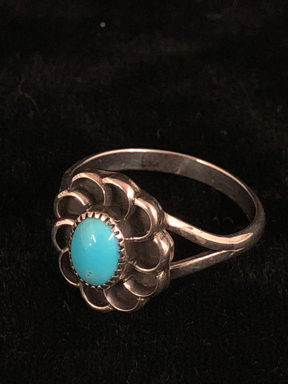 Turquoise with floral design sterling silver ring