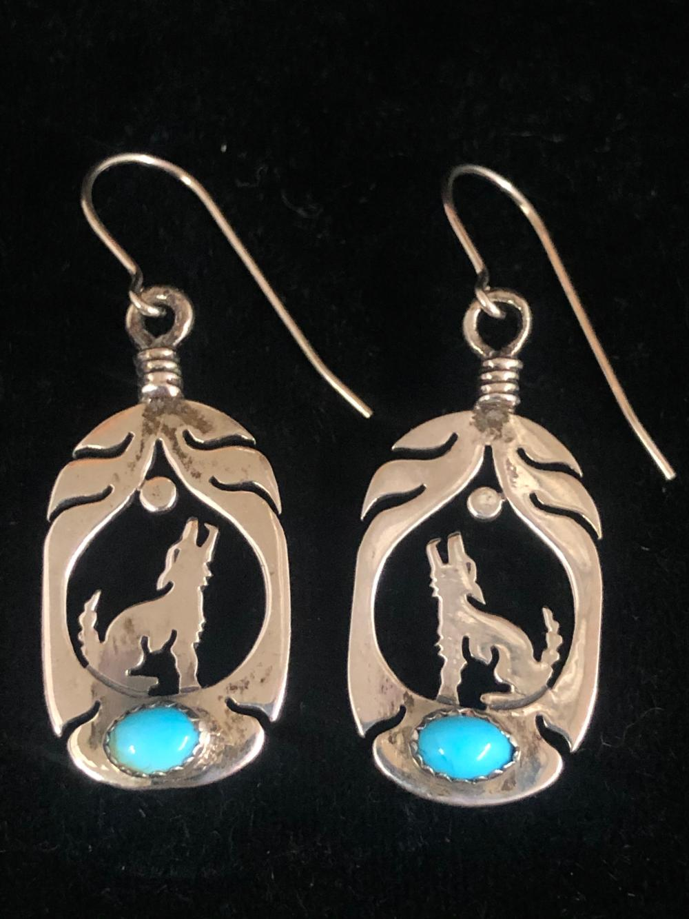 Howling wolf in feather with turquoise sterling silver earrings