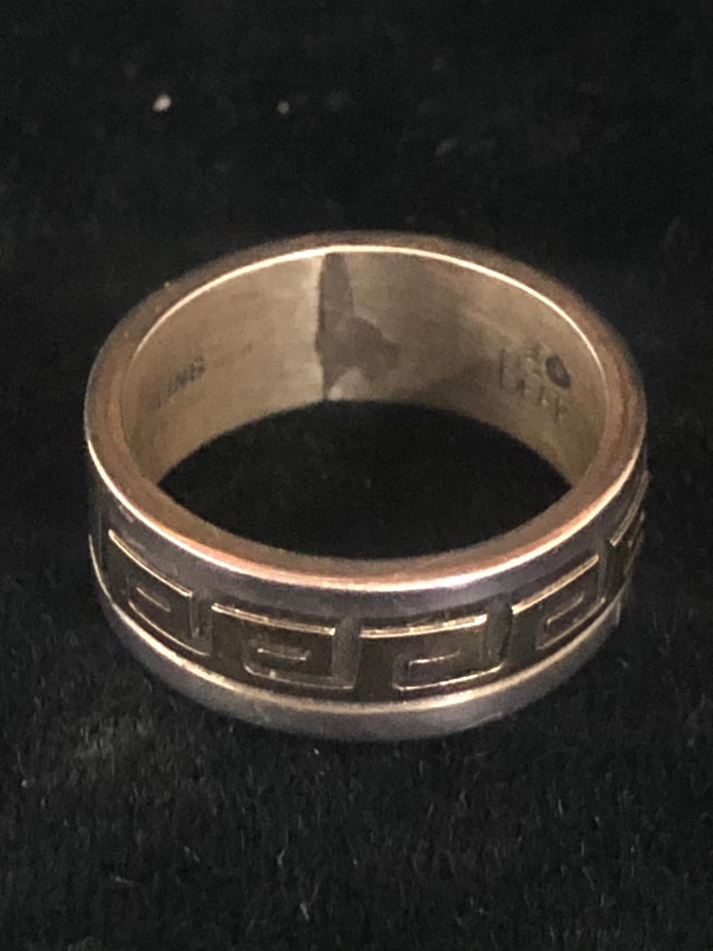 Sterling silver and 14k gold fill band ring with design