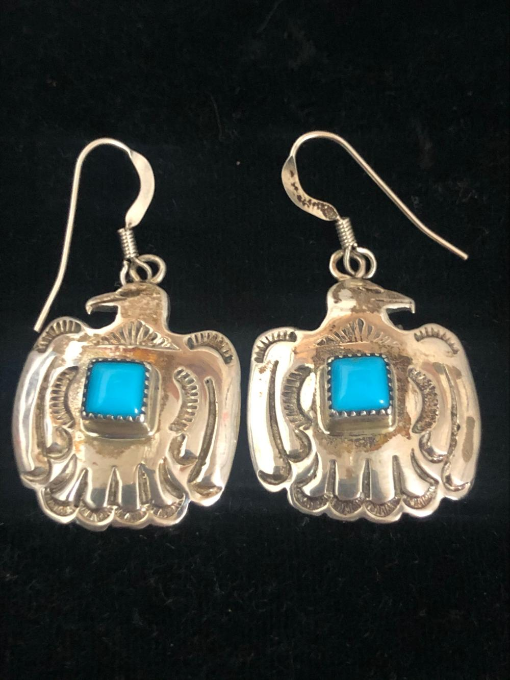 Eagle shaped sterling silver earrings with turquoise stone