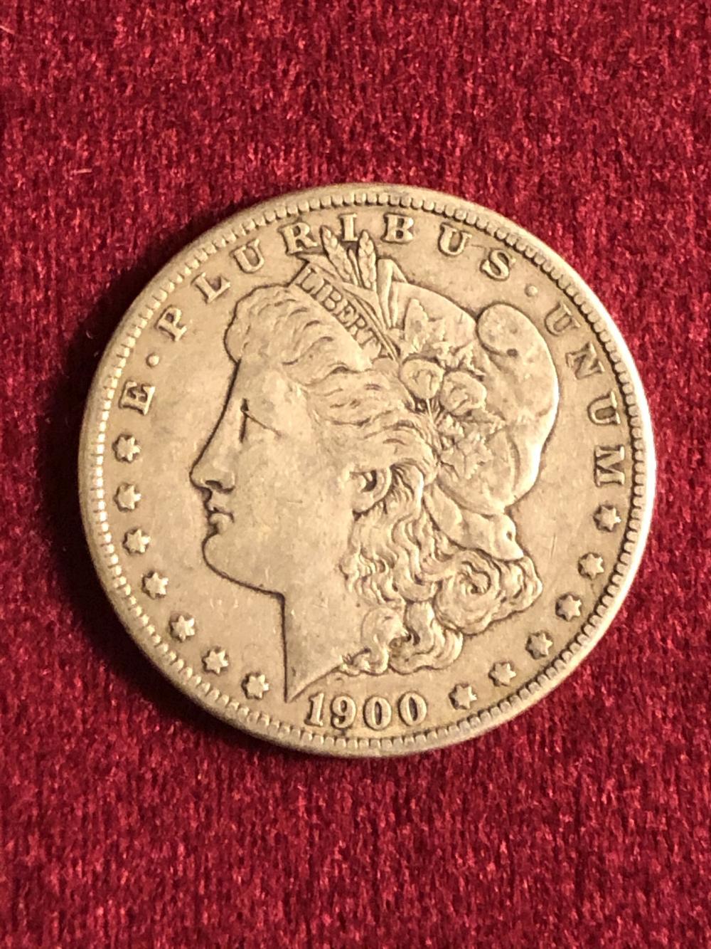 1900-O morgan silver dollar coin