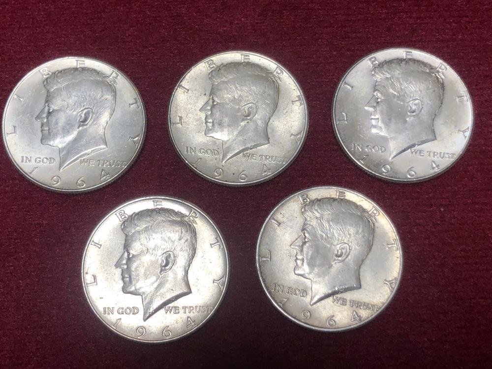 Five 1964 silver Kennedy half dollars