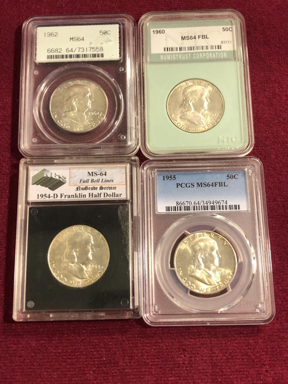 Four graded Franklin silver half dollars