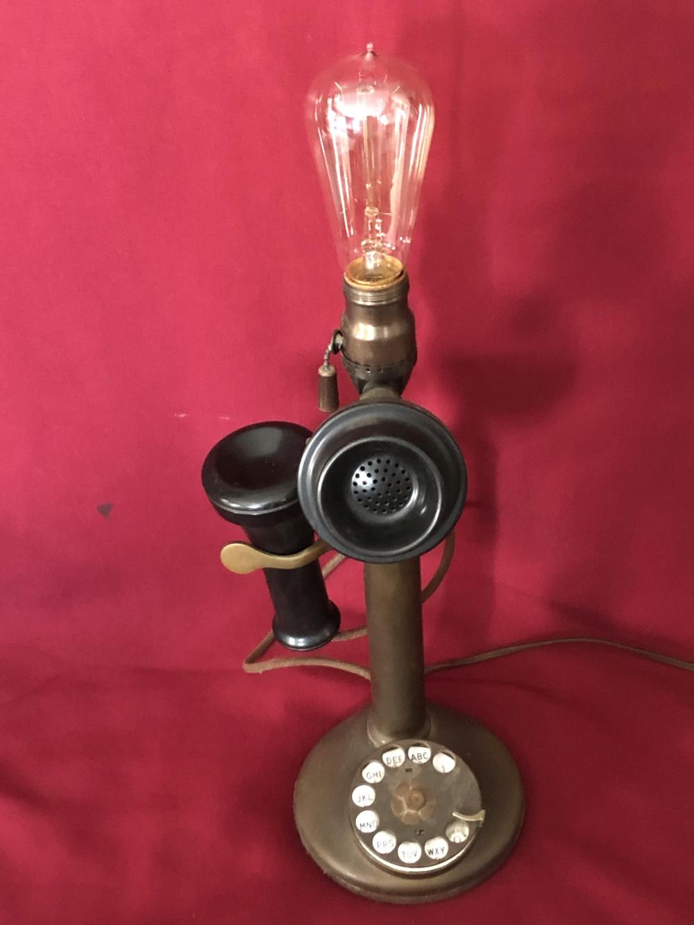 Antique brass telephone with light